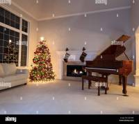 Bright Christmas tree in living room with burning ...