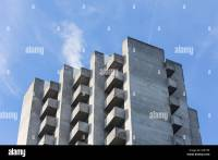 brutalism concrete highrise apartments with balcony on a
