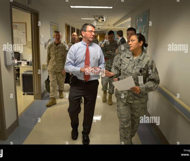 U S Air Force Staff Sgt Teresa Moldes Right Escorts Deputy Secretary Of Defense Ash Carter Down A Corridor At Brooke Army Medical Center In San Antonio