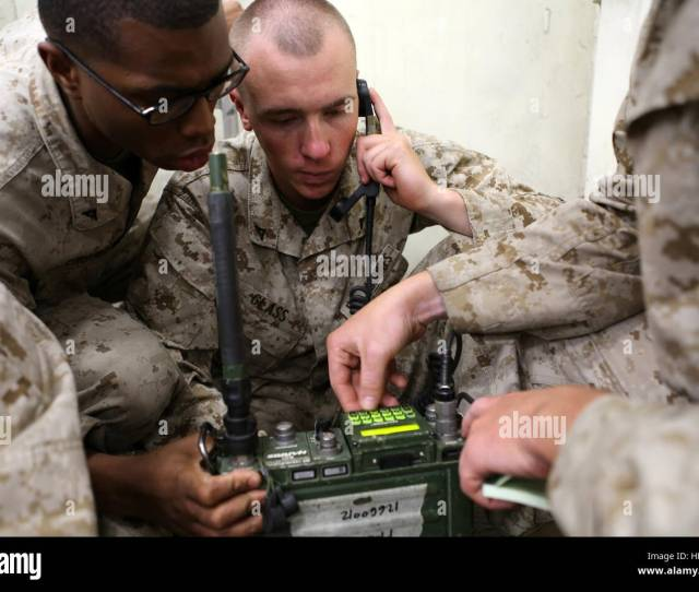 Lance Cpl Shaun Engram Left A Field Radio Operator With Headquarters And Service Company Teaches Lance Cpl Davis Glass Center A Rifleman With Kilo