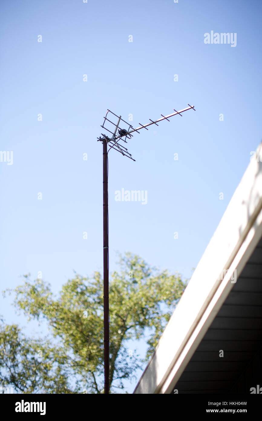 medium resolution of old style antenna and blue sky satellite dish signal broadcasting technology