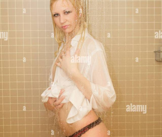 Pretty Blonde Young Woman In Shower Wearing A Shirt