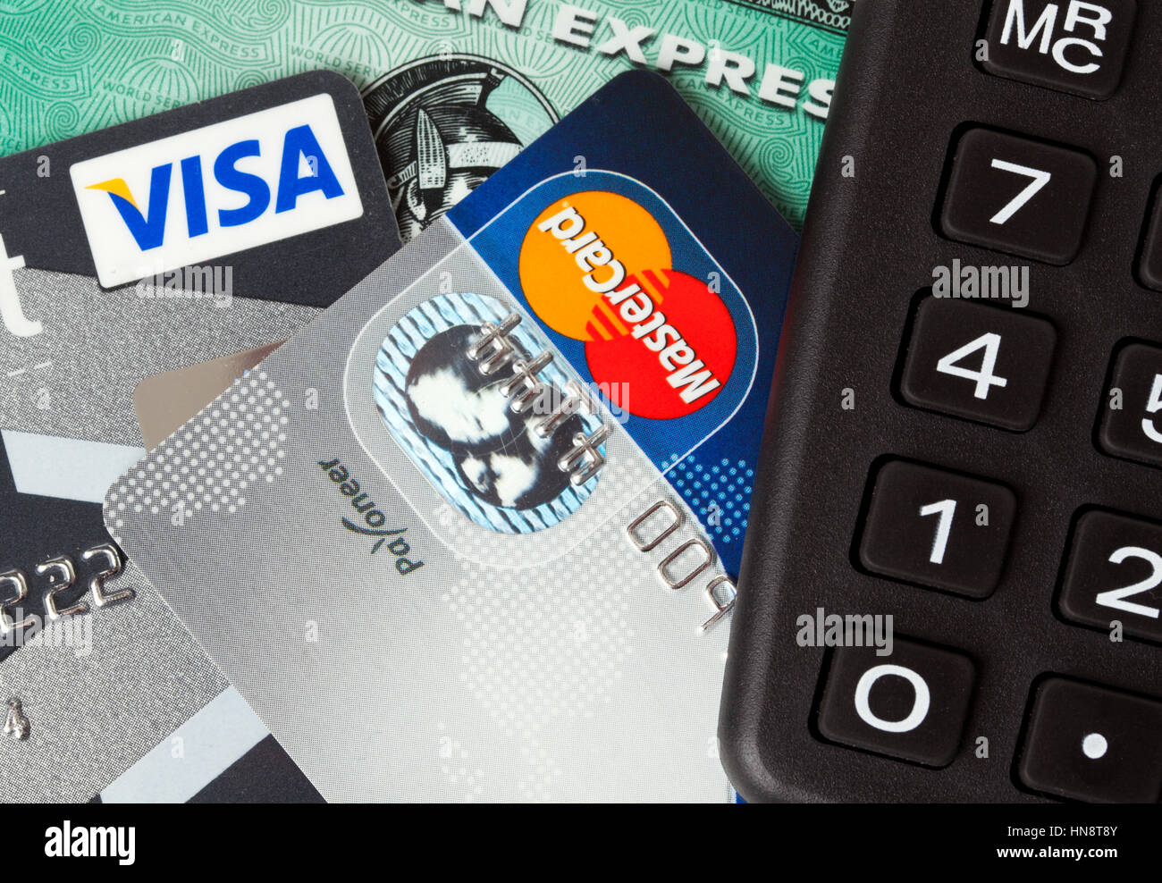 Some may not see improved scores or approval odds. Closeup Of Credit And Debit Cards Issued By Three Major Brands Visa American Express And Mastercard With A Pocket Calculator Stock Photo Alamy