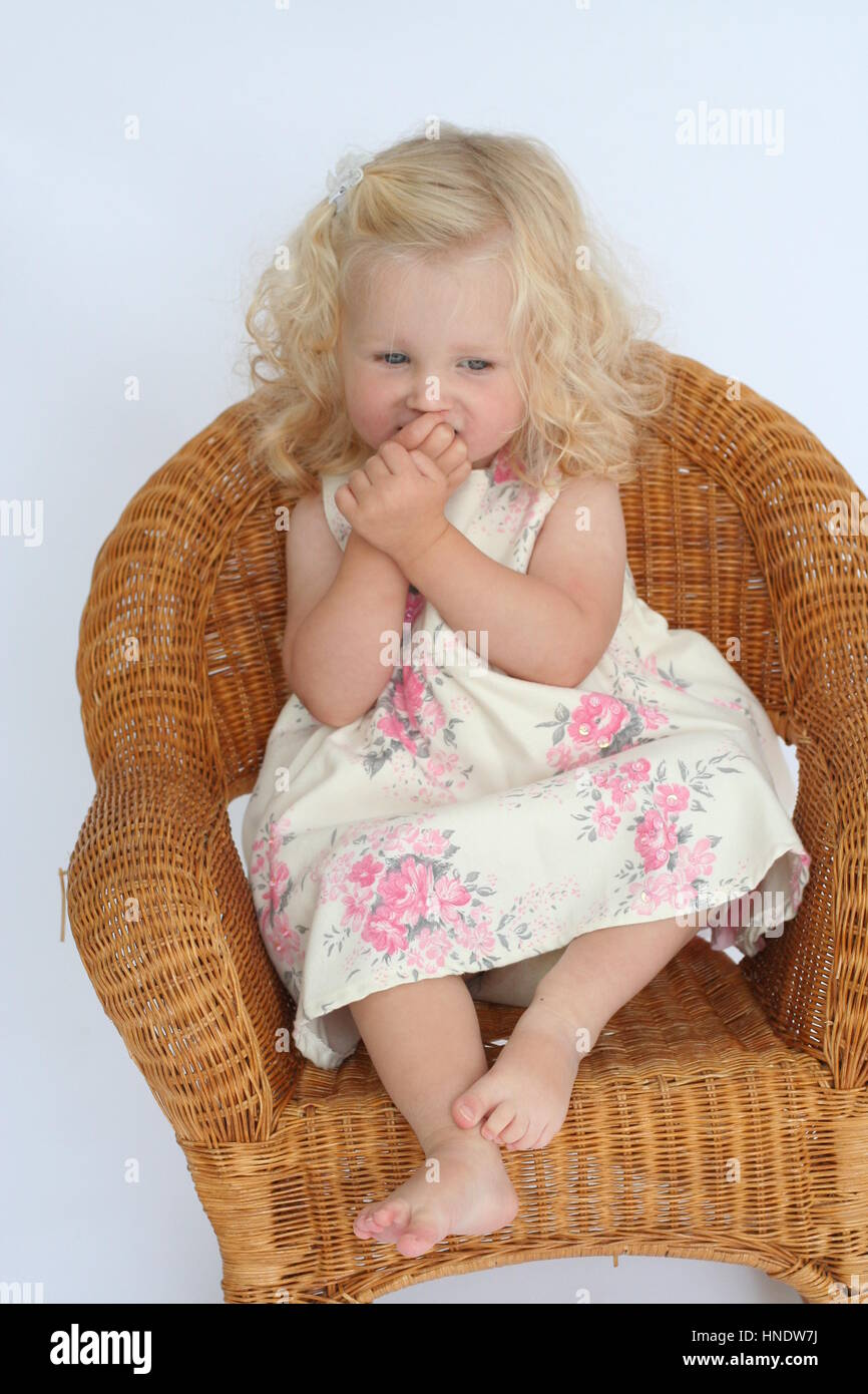 chair for toddler girl how to adjust aeron little curly blonde sitting in a wicker stock