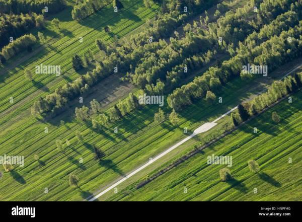 man- landscape. furrowed fields