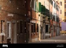 Narrow Cobblestone Alley In Historical Center Of
