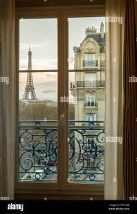 The Eiffel Tower, Paris, France, through an apartment ...