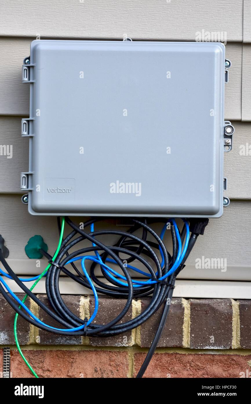 medium resolution of verizon internet and cable box on outside of home stock image