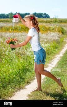 Beautiful Blonde Girl Walking Barefoot Stock