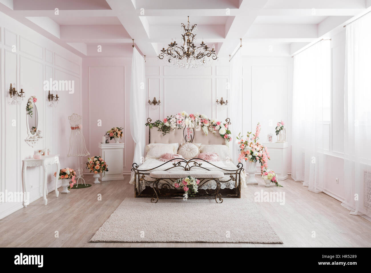 https www alamy com stock photo wrought iron bed in the gentle light room spring flower decoration 134721225 html