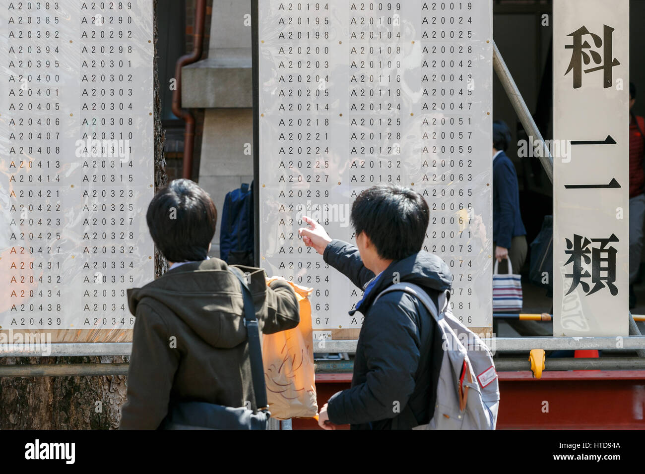 Japanese Students Look For Their Exam Numbers On The List