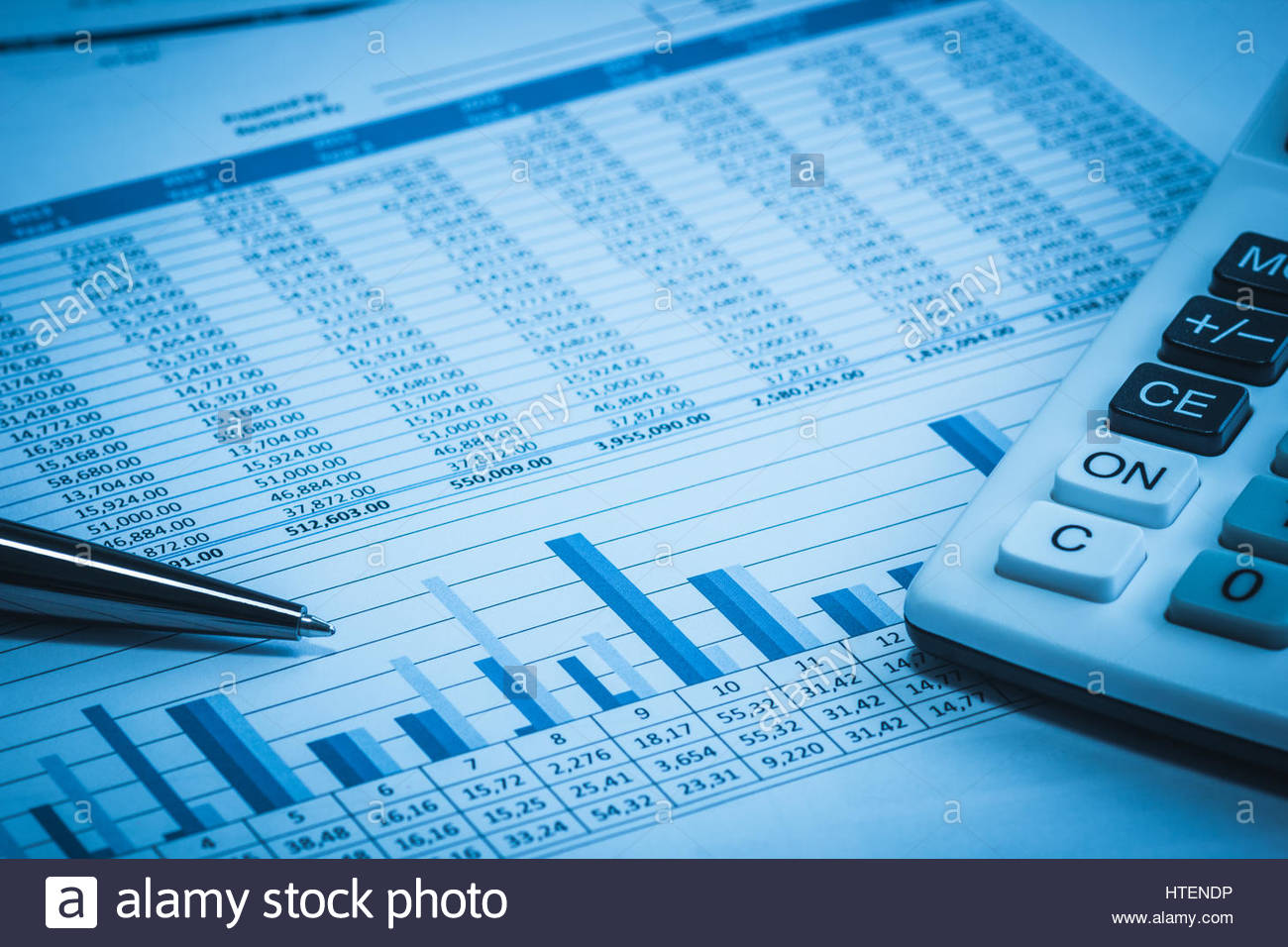 Accounting financial banking stock spreadsheet data with pen and ...