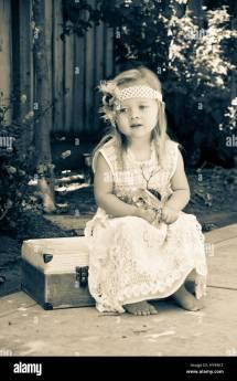 Little Girl Sitting Wearing Dress Barefoot
