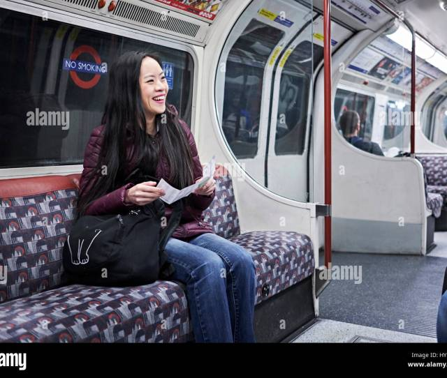 A Young Japanese Woman On A Tube Train In London