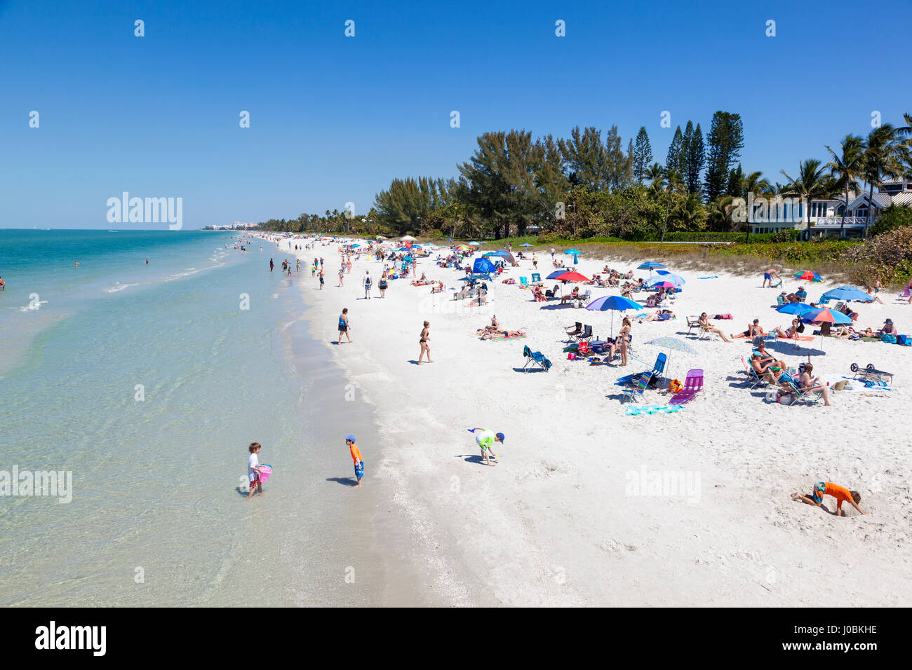 hight resolution of naples fl usa march 18 2017 beautiful white sand beach at the gulf of mexico coast in naples florida united states