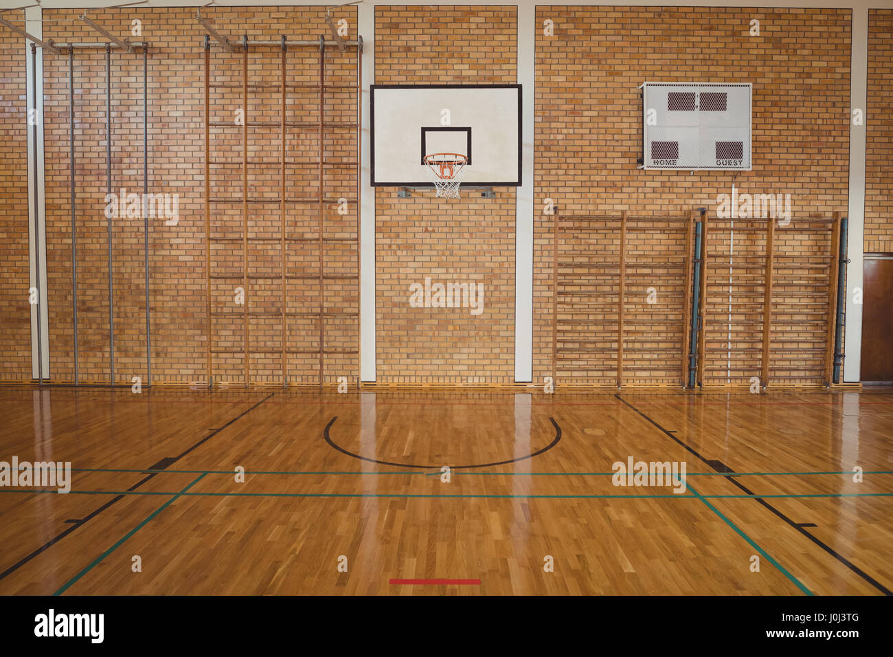 Empty basketball court in high school Stock Photo Royalty