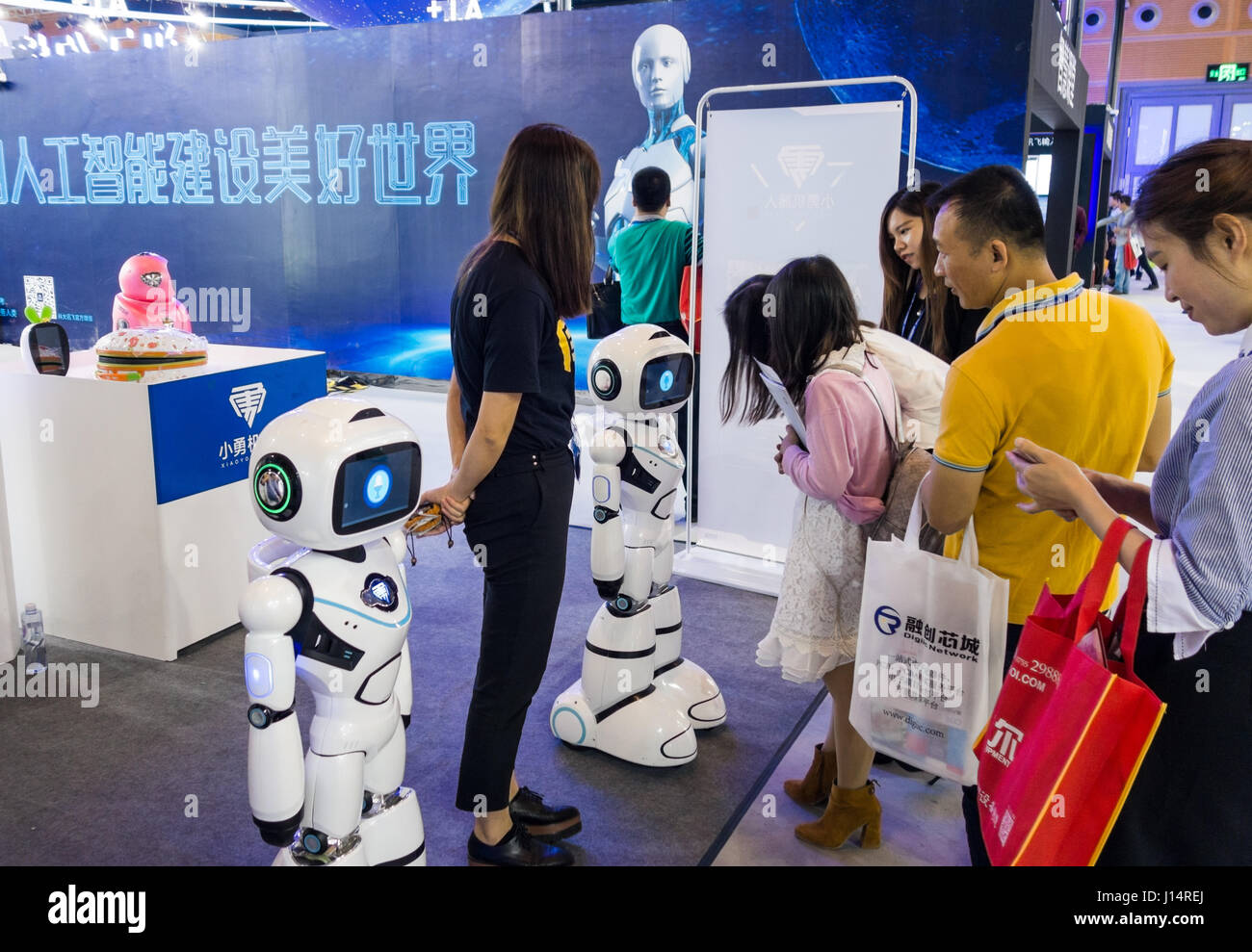 robots surrounded by visitors