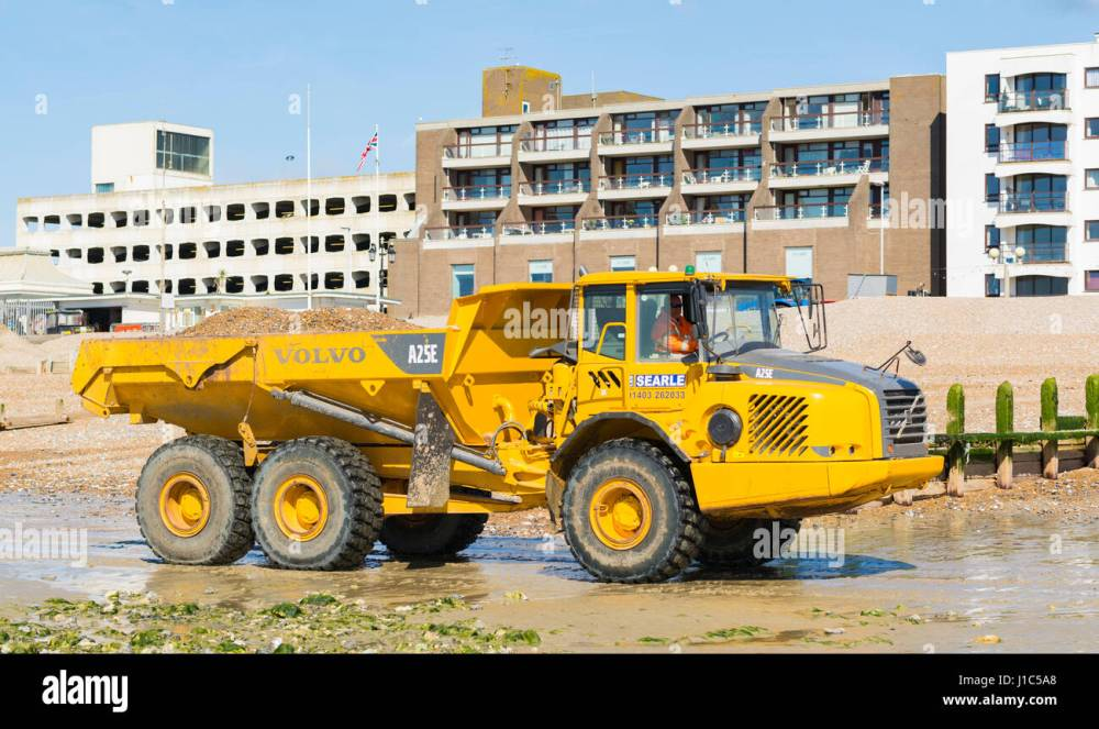 medium resolution of volvo a25e articulated hauler dump truck moving shingle on worthing beach worthing