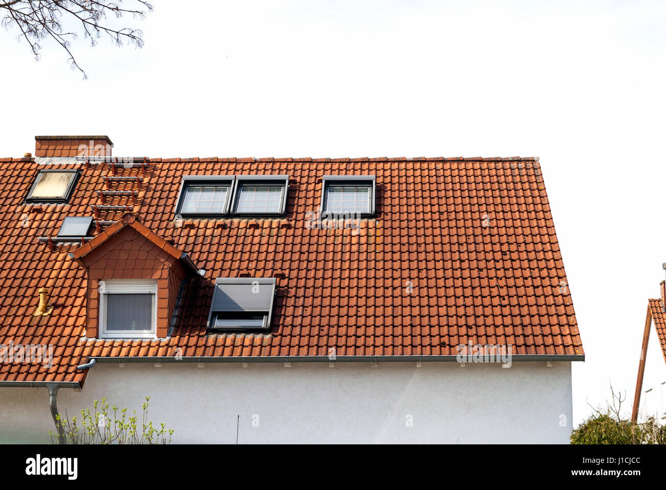 https www alamy com stock photo roof of classic residential houses with orange roofing tiles and windows 138575484 html