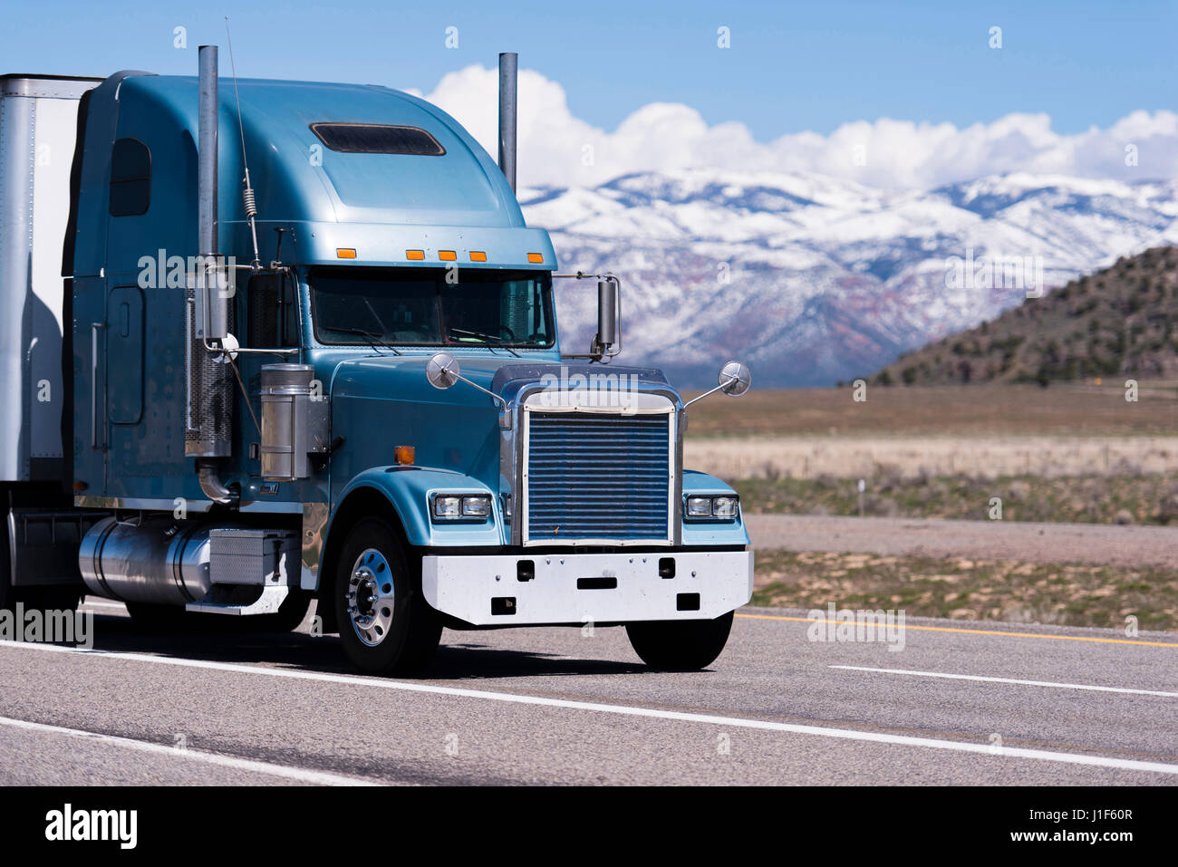 https www alamy com stock photo classic big rig blue semi truck with trailer and tall exhaust pipes 138631607 html
