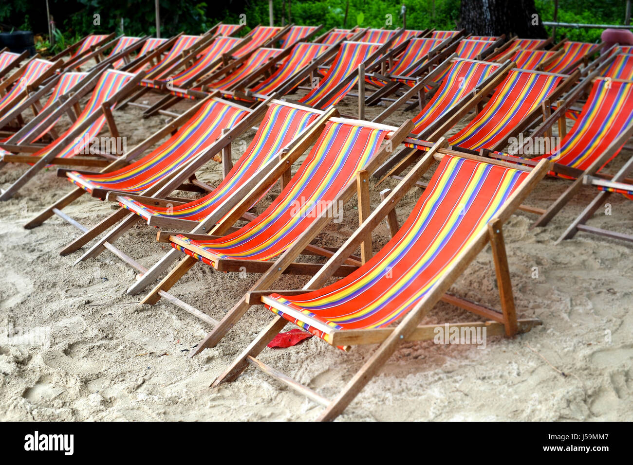 Sunbathing Chairs Pile Of Relaxation Sunbathing Chairs On Beach Stock Photo