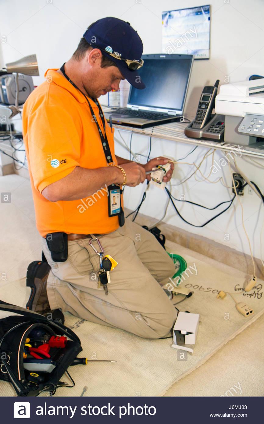 medium resolution of miami beach florida at t u verse cable internet hispanic man technician installation job tools