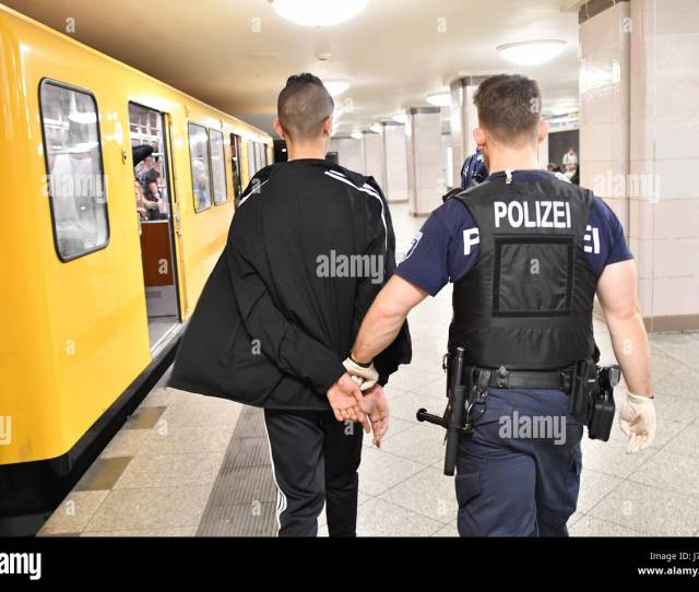 A Police Officer Escorts A Suspected Pickpocket In The Borough Of Kreuzberg In Berlin Germany  A Special Police Group Has Been Patrolling