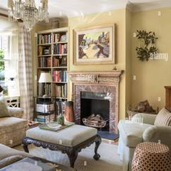 Traditional English Living Room Design Minimalist Small Space Style With Howard Armchair Lacquer Chest From Colefax Fowler And Antique Chandelier