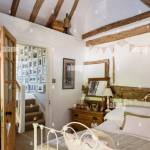 Vaulted Master Bedroom With Ancient Beams And Wrought Iron Bed From Stock Photo Alamy