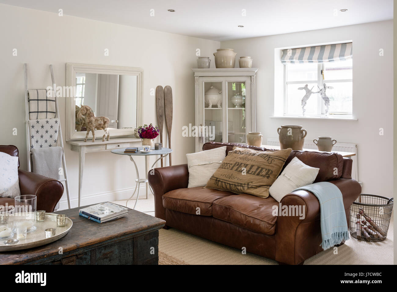 leather sofa designs for living room india paint colors images laura ashley and grey armoire from scandi in sitting with indian dowry chest decorative oars the walls are painted po