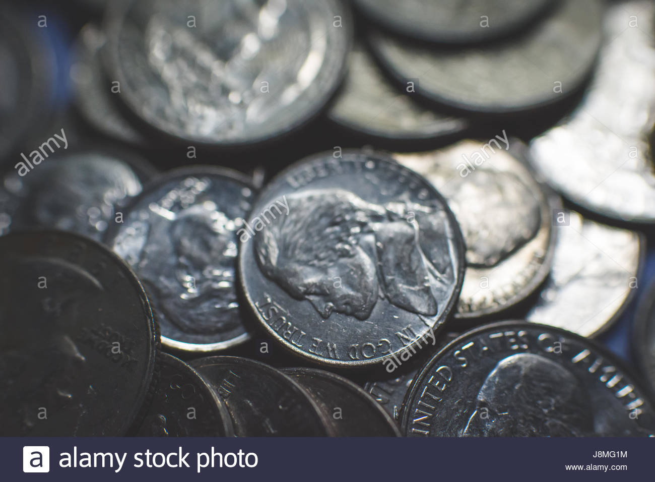 A Pile Of American Currency Coins Including Quarters