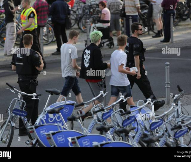 Berlin Germany Th May  Police Officers Escort A Group Of Youth Past The Protest A Handful Of Right Wing Protesters Came To Their Weekly Rally In