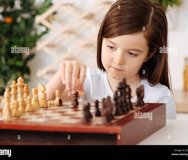 Playing Herself Smart Little Girl Making A Move With A Pawn Playing Alone And Being Involved In The Process While Her Father Being Away