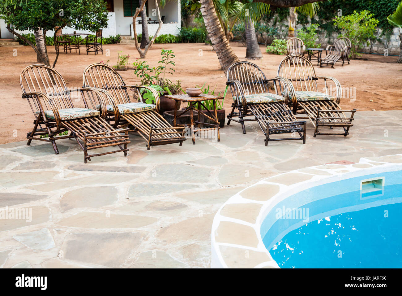 what are pool chairs made out of comfy outdoor chair elegant wood close to a swimming inside kenyan garden
