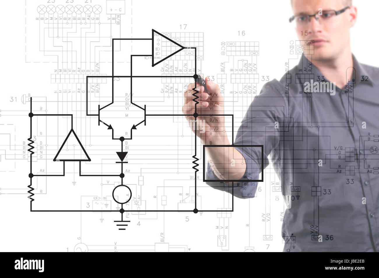 hight resolution of electrical engineer drawing circuit diagram on the whiteboard