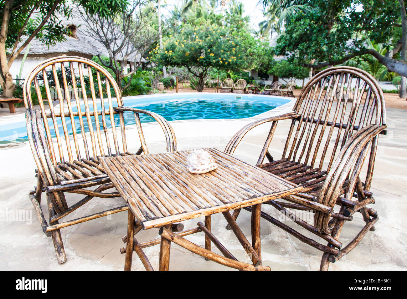what are pool chairs made out of orthopedic high seat chair for the elderly elegant wood close to a swimming inside kenyan garden