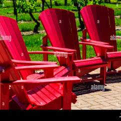 Red Adirondack Chairs Dining Slipcovers Stock Photos Group Of Also Known As Muskoka Image