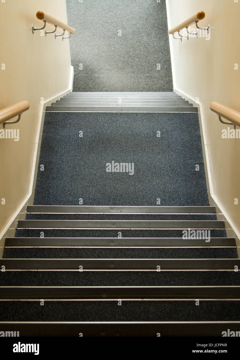 Stairway Going Down In Office Block With Hand Rails And Blue   Carpet Down Middle Of Stairs   Stair Rods   Wood   Hardwood   Steps   Laminate Flooring