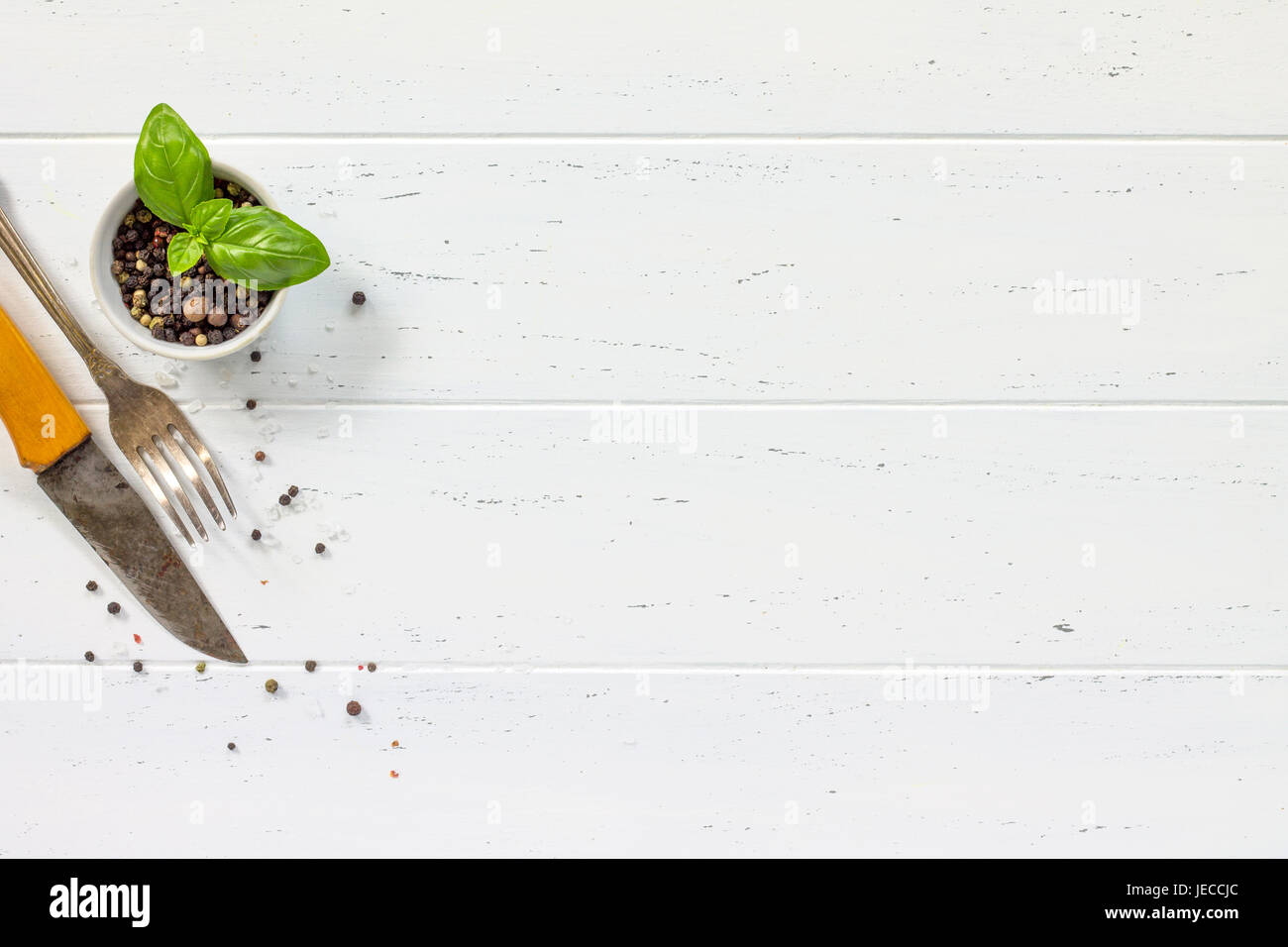 White wooden kitchen table. Background cooking with fresh