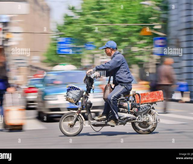 Man Rushes On An Electric Bike Many Scooter And E Bike Riders Drive Fast And Reckless As A Result Of Poor Traffic Law Enforcement