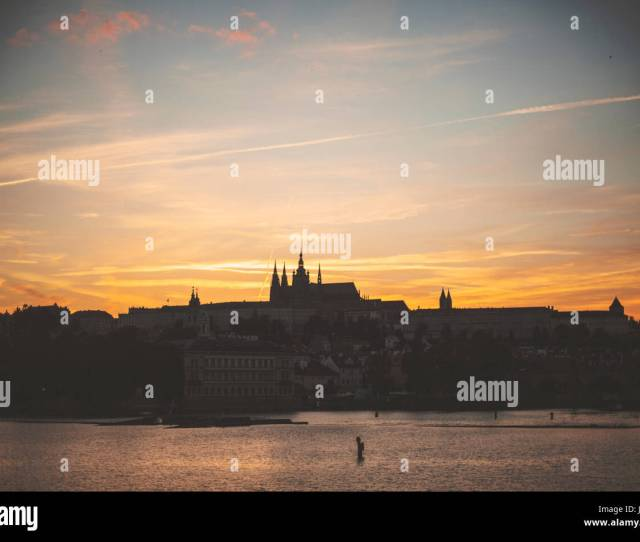 Prague Castle Silhouetted Against The Setting Sun