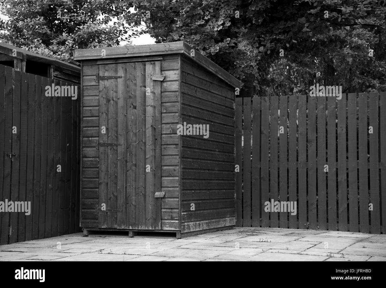 https www alamy com stock photo black and white image of a small wooden garden shed on a patio in 147421329 html