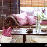 Brown Leather Chaise Longue With Pink Cushions In Front Of Windows Stock Photo Alamy