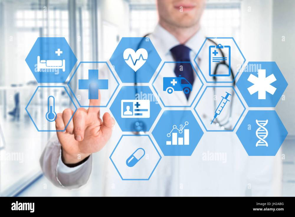 medium resolution of medical doctor touching icons of health care services on a digital screen with hospital interior
