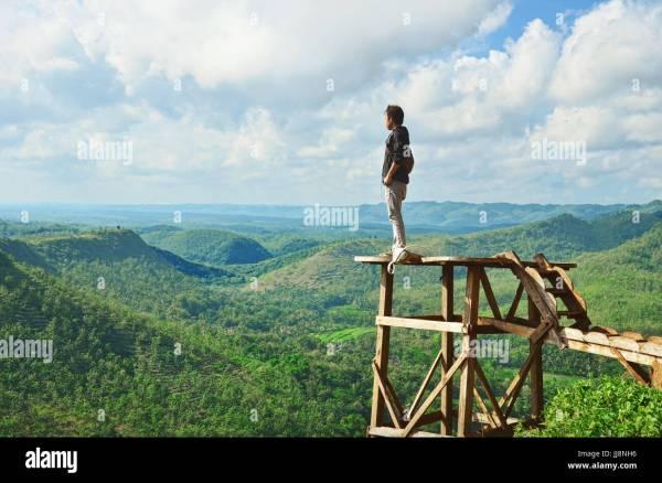 man staring breathtaking landscape