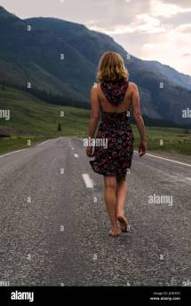 Woman Running Country Road Stock &