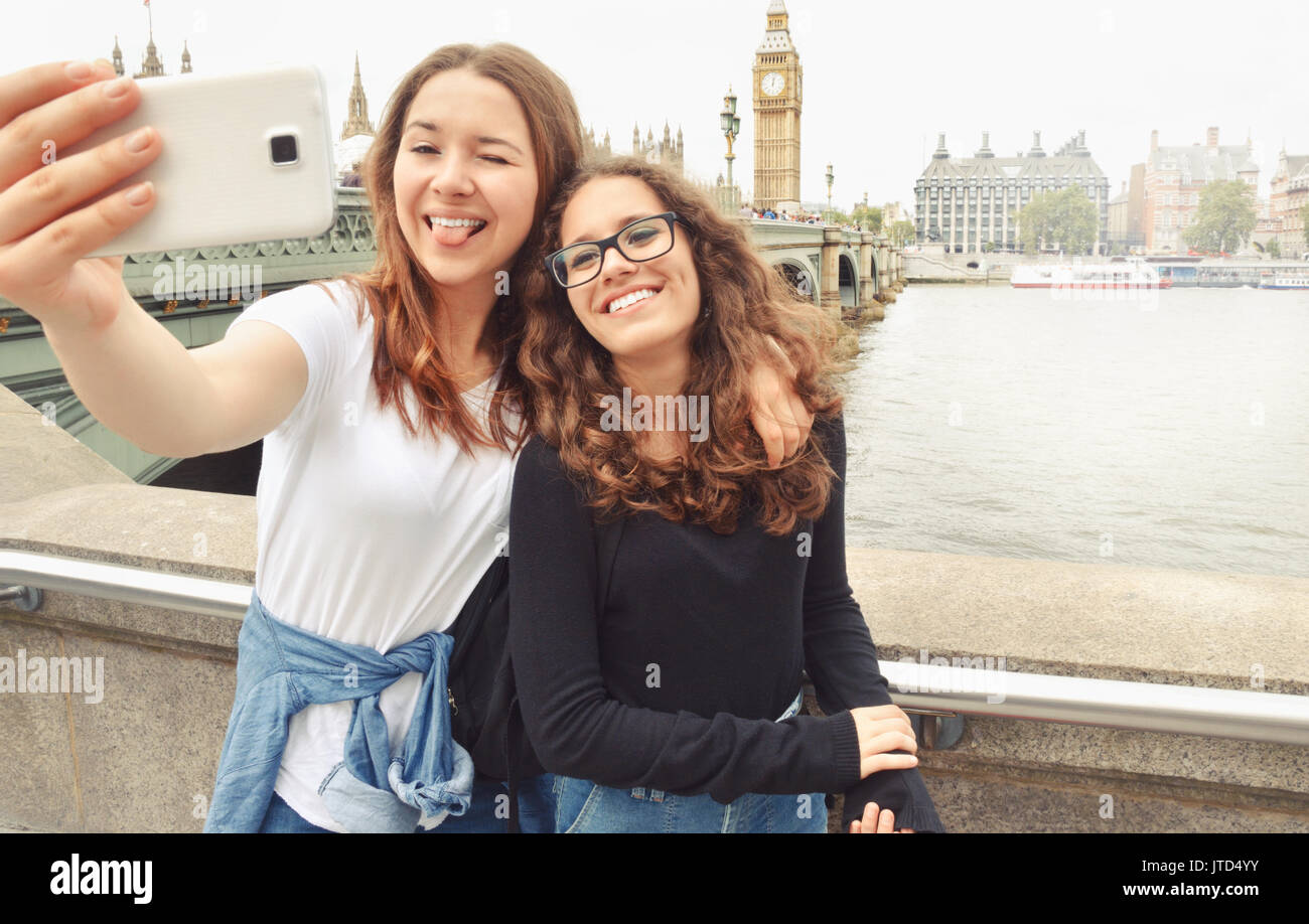 Happy Smiling Pretty Teenage Girls Taking Selfie At Big Ben London Travel And Tourism Concept