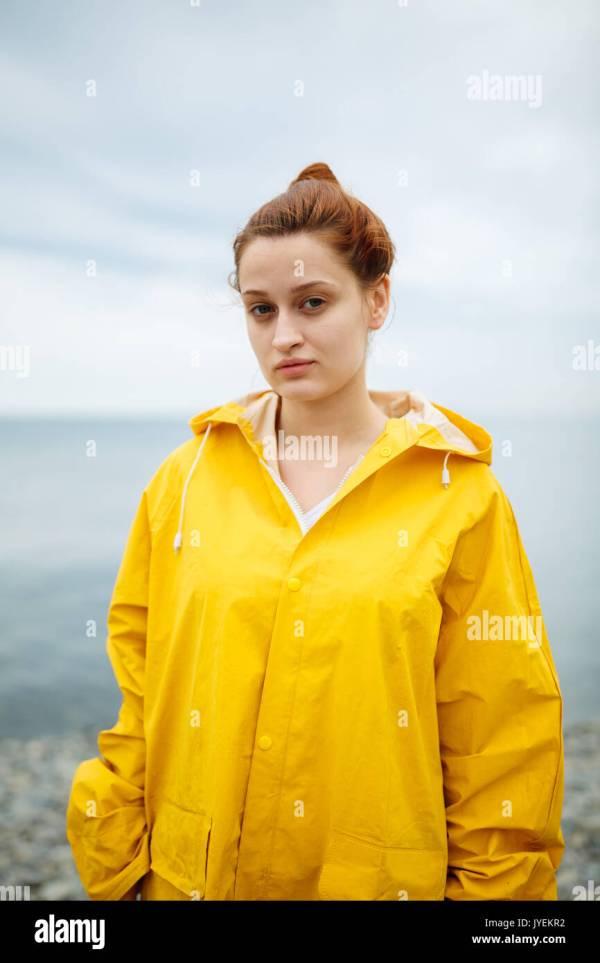 Girl Wearing Yellow Raincoat Stock 154601526 - Alamy