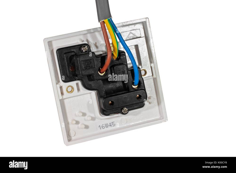 medium resolution of a 250v 13a electrical socket outlet viewed from behind showing wiring isolated on a white background