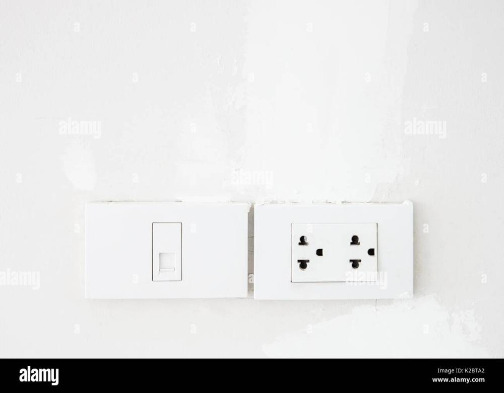 medium resolution of electrical switch and telephone socket on the white wall in the living room copy space